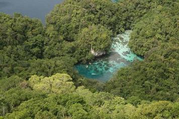 Secret Palau cove via helicopter's bird's eye view
