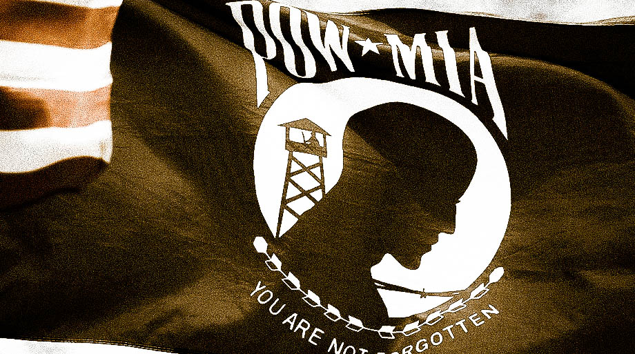 POW MIA Flag with American Flag touching flying high and proud.