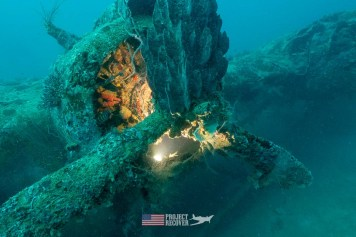 A Mavis Japanese flying boat engine WWII wreck in the Solomon Islands during Solomons MIA Search - Project Recover and BentProp Project are committed to bringing the MIA home. Photos by Harry Parker Photography.com