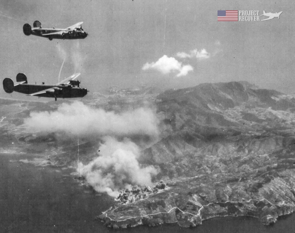 Porto Santo Stefano, Italy burning during WWII as huge explosions can be seen after the bomb run. - Project Recover is committed to bringing the MIA's home