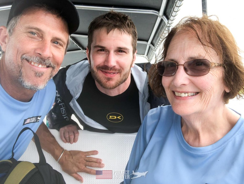 Harry Parker (photographer), Cindy and her son, Adam, Gray (MIA Family) after Adam dove to uncle's WWII wreck. Photo by Harry Parker Photography.com