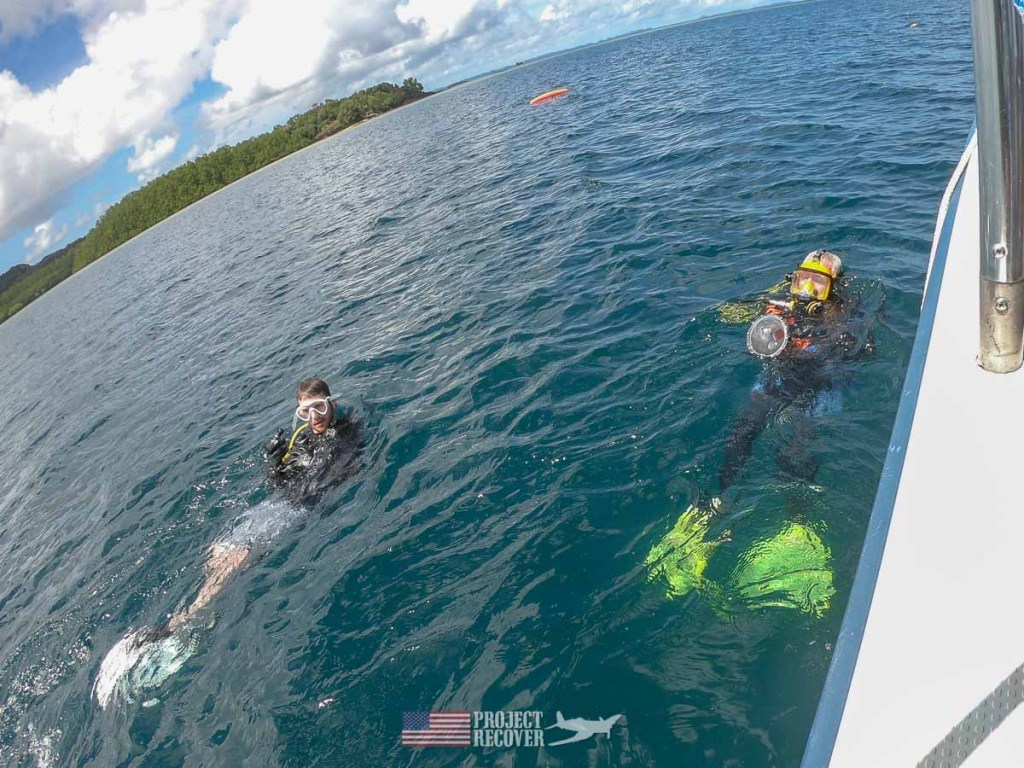 Adam (MIA Family) and Flip about to dive to Bud Rybarczyk's WWII wrecked plane. Photo by Dan O'Brien