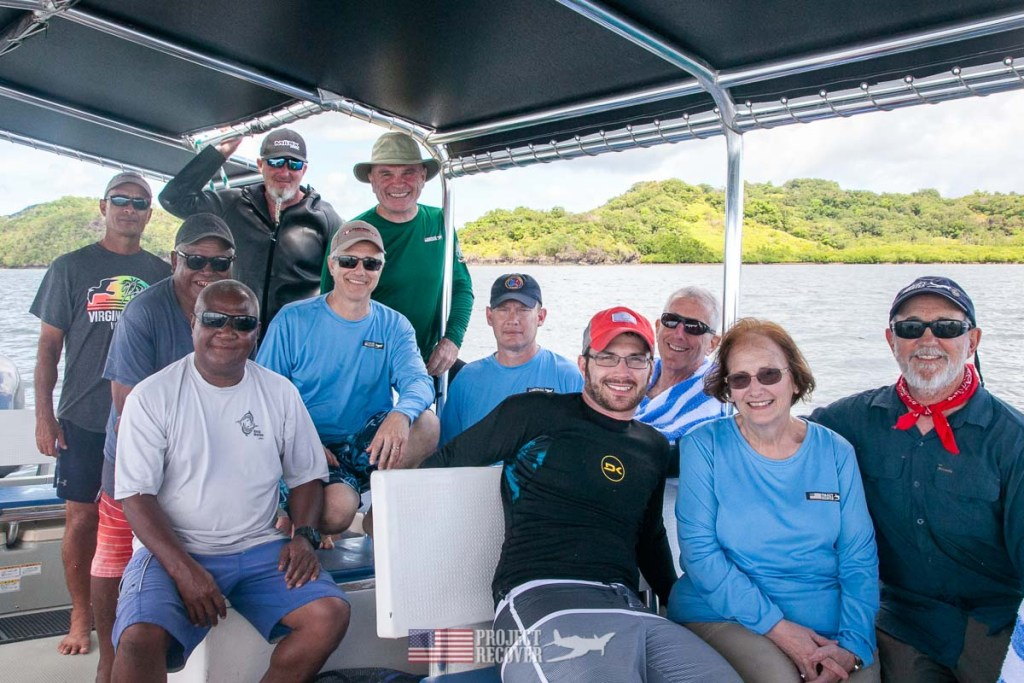 Project Recover team photo with MIA Family on boat in Palau. Photos by Harry Parker Photography.com