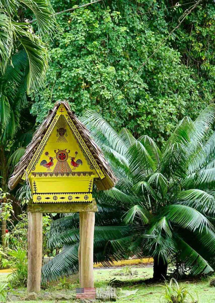 a replica of a Bai in the jungle of palau