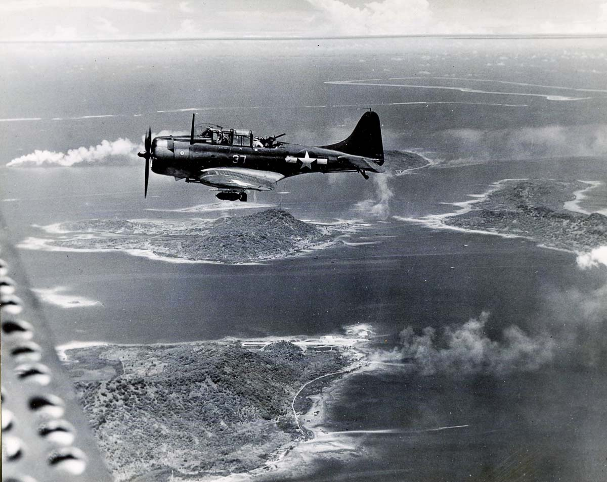 WWII aircraft in Chuuk - an SBD Flying high during