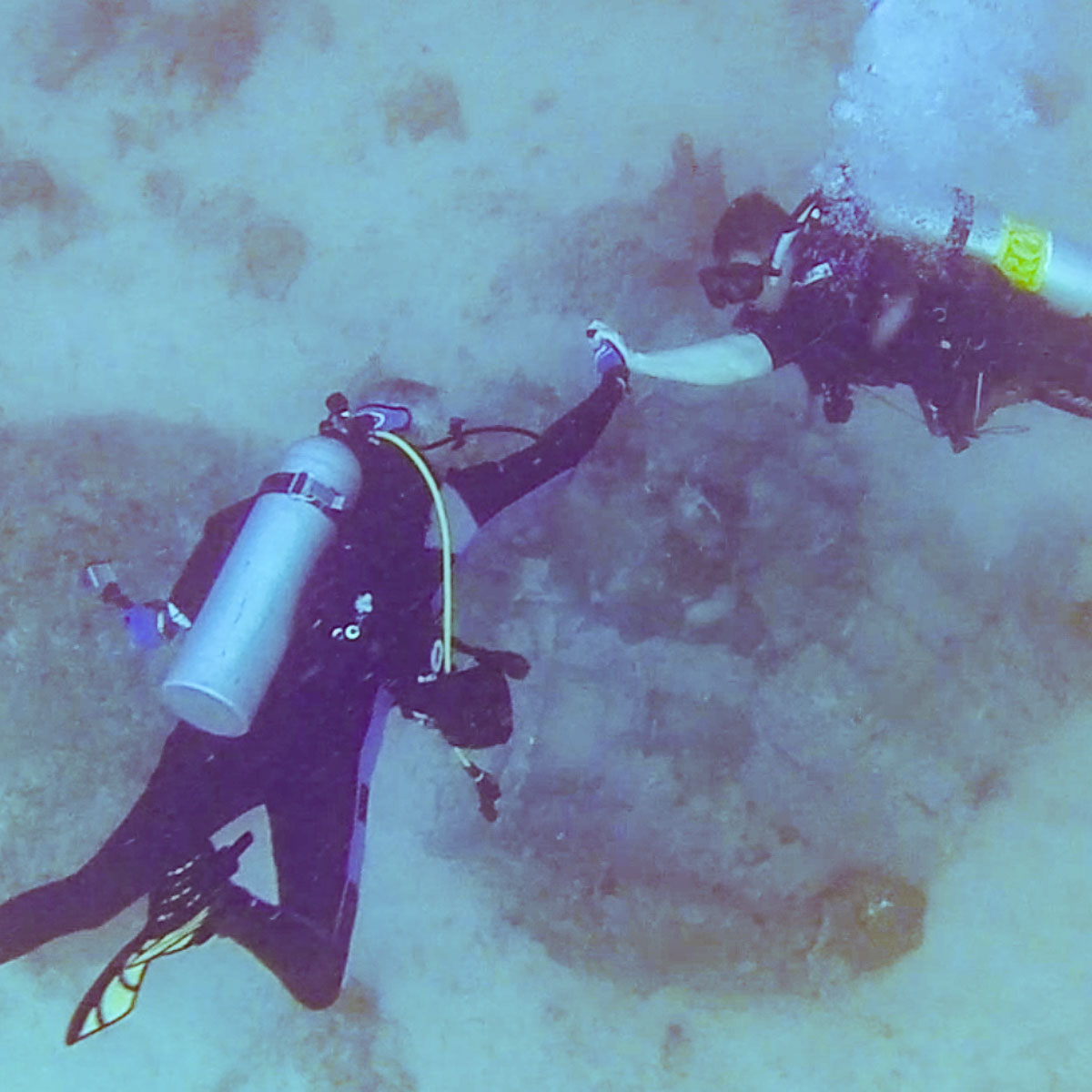 "Scuba Divers giving a ""High Five"" after finding an MIA Crash Site"