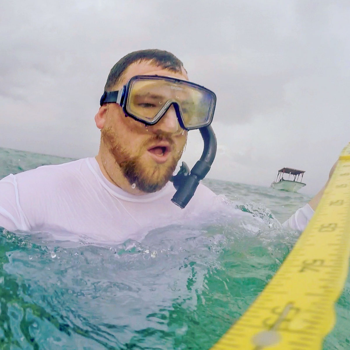 Colin Colbourn measuring while snorkeling