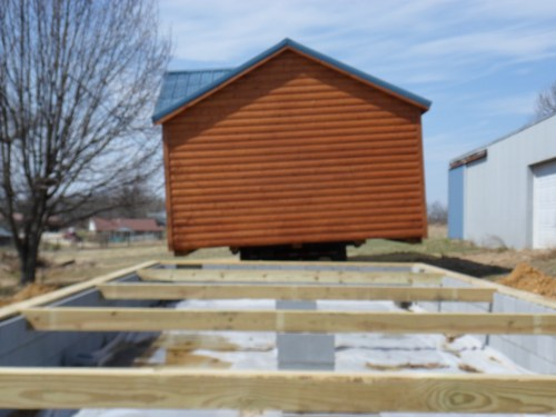 Amish Made Cabin being installed on a block foundation