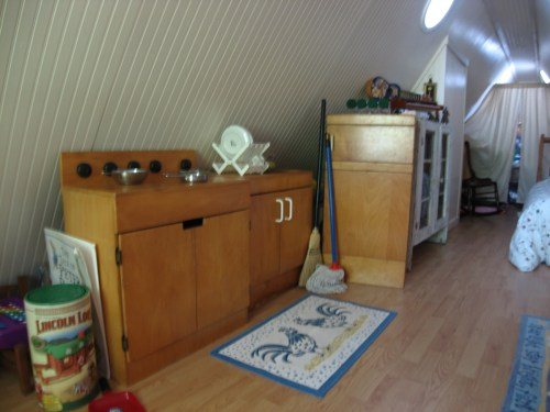 Project: Turning the Attic into a Playroom - The room runs the entire length of the house, but it is only tall enough for adults to walk in the center. It is a great play room!