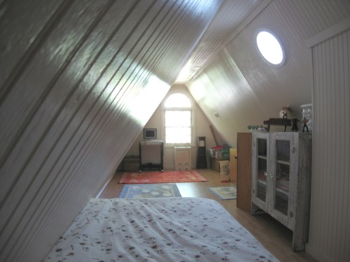 Project: Turning the Attic into a Playroom - The walls are made of clear birch wood beadboard, sanded and painted with high gloss paint.