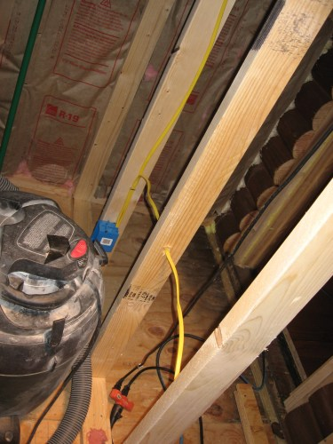 Project: Adding Closets to the log cabin - Wiring in the closet. The framing is the back of the guest room closet wall.