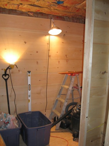 Project: Adding Closets to the log cabin - We finished the closet walls with wood, some of it cedar.