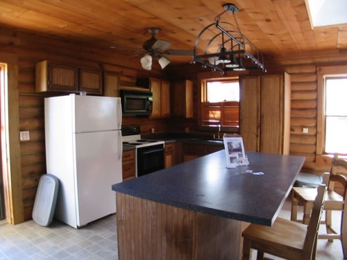 Log Cabin Kitchen Before & After: This was the kitchen when I first bought the log cabin