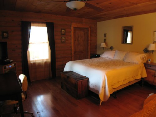 Project: Adding Closets to the log cabin - The bedroom, with the new closets.