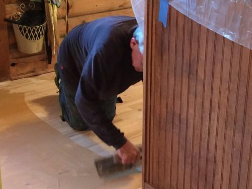 Project Small House - Refinishing Hardwood Floor: Mark puttied the whole floor.