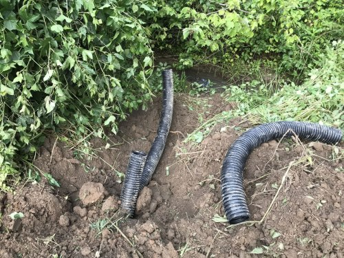 Drain lines out to the gully. They aren't done yet. - Downspout Drain Lines– Project Small House