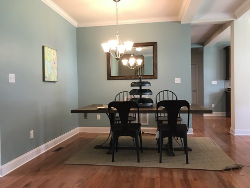 Dining room is close to the kitchen. The hallway leads to the laundry room, two bedrooms and a bathroom. - Modular Homes: The Maiden II at Premier Homes of the Carolinas – Project Small House