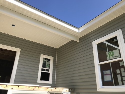 The front porch ceiling with the completed fascia and soffit - Installing the Vinyl Siding - Building Our Schumacher Home - Project Small House