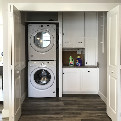 Convenient Laundry with Storage - New Modular at Premier Homes of the Carolinas – Project Small House