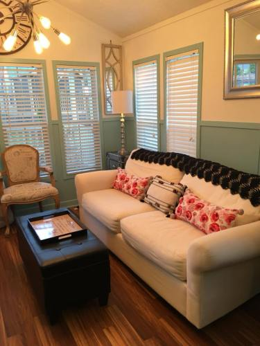 The living room has a full size sofa - See Inside the Tardis Tiny House – Project Small House
