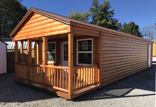 The cabin is 14' x 38'. The interior is 14' x 32'. The porch is 6' x 14'. There is loft storage over the porch. - Clearance 14 x 38 Log Cabin – Project Small House