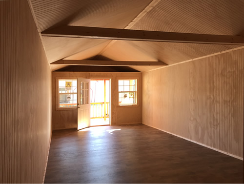 Wide open inside, vinyl floor and bead-board walls - Clearance 14 x 38 Log Cabin – Project Small House