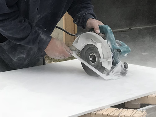 Cutting the hole for the handle - Cultured Marble Vanity Tops and Tub Surround – Project Small House