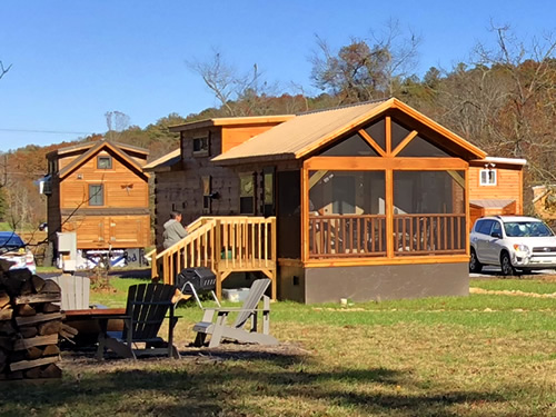 Tiny Log Cabins near a Community Fire Pit - Open House at Acony Bell Tiny Home Village – Project Small House