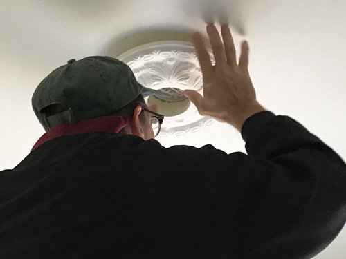 Making sure the electric box is perfectly centered - Ceiling Medallions in the Dining Room and Entry – Project Small House