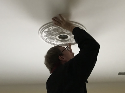 Lining up the medallion - Ceiling Medallions in the Dining Room and Entry – Project Small House