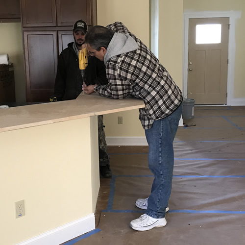Fastening a board to the bar to support the Corian - Corian Countertops in the Kitchen - Schumacher Homes Cross Creek – Project Small House