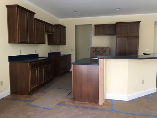 From the dining room side - Cobalt Blue Corian Countertops in the Kitchen - Schumacher Homes Cross Creek – Project Small House