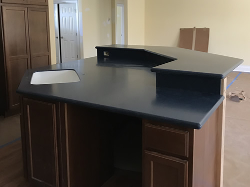 This side is by the dining room - the counter is low to make it easy to clear the table - Cobalt Blue Corian Countertops in the Kitchen - Schumacher Homes Cross Creek – Project Small House