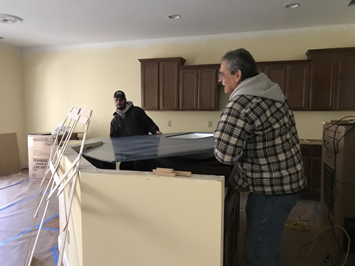 Sliding the counter in place - Cobalt Blue Corian Countertops in the Kitchen - Schumacher Homes Cross Creek – Project Small House