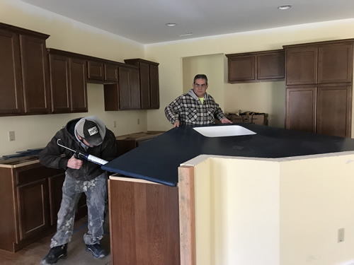 Silicone to secure it in place - Cobalt Blue Corian Countertops in the Kitchen - Schumacher Homes Cross Creek – Project Small House