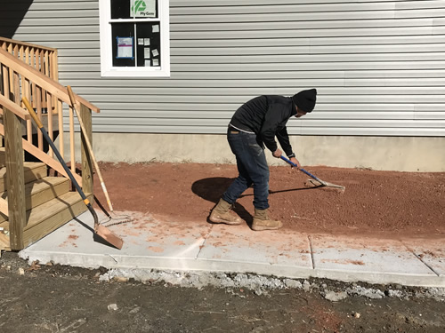 Raking to remove the larger rocks - Grading Above Flood Plain, Gravel Driveway and Grass Seed - Project Small House