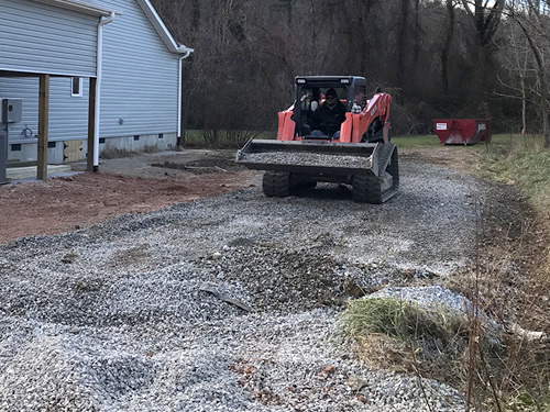 The grader scraped up the gravel from where it had been scattered - Grading Above Flood Plain, Gravel Driveway and Grass Seed - Project Small House