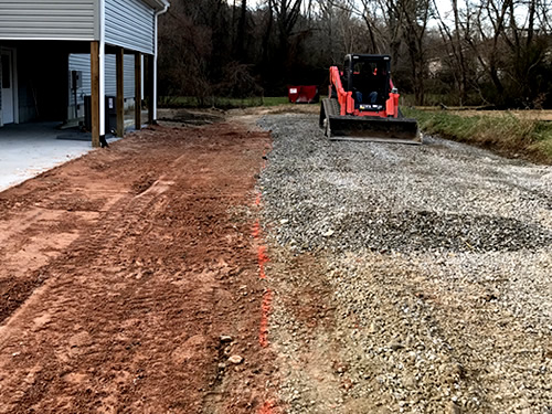 The grader marked where the driveway should be - Grading Above Flood Plain, Gravel Driveway and Grass Seed - Project Small House
