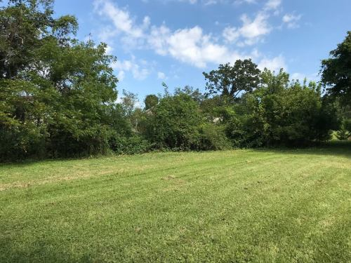 The center is mowed, the edges are wooded - Land For Sale: .44 acre In Druid Hills, Hendersonville, NC – Project Small House