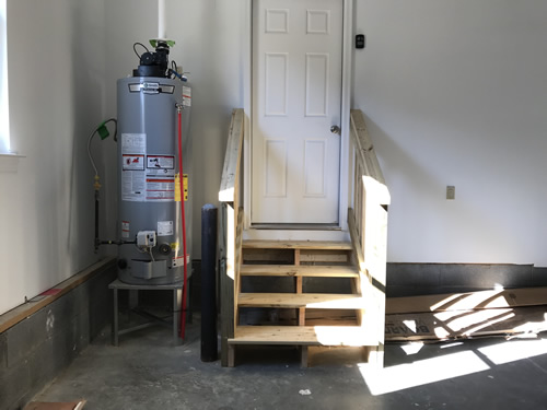 The hot water heater is hooked up and we have steps into the laundry room - The Plumbers Return Again - Project Small House
