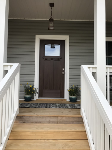 The front door with pots of daffodils - Getting Settled and Enjoying Spring – Project Small House