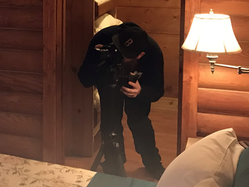 Standing in the closet to get a shot of the master bedroom - Getting the Cabin Ready to be a Vacation Rental - Photographer