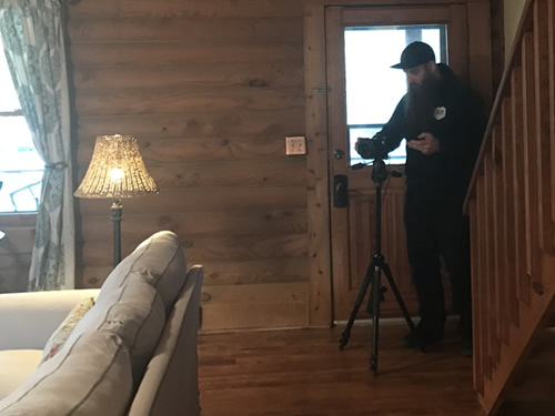Jeremy with Red Rabbit Media photographing the cabin - Getting the Cabin Ready to be a Vacation Rental - Photographer