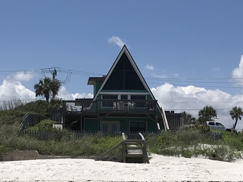 There is a wrap-around deck and steps out to the beach