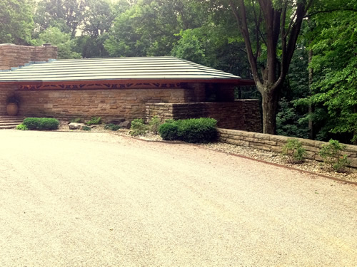 A stone planter finishes the side of Kentuck Knob. Portion of photo by Kafziel