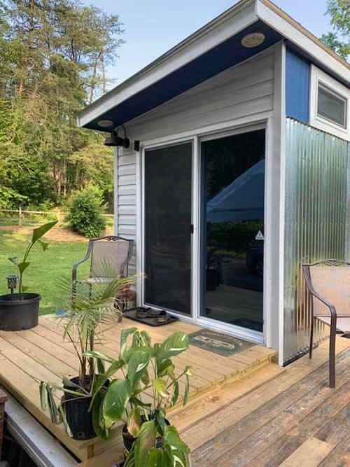 Sliding glass doors open to an 8-foot deck