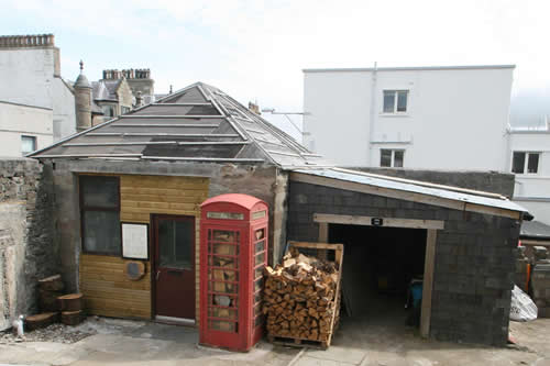 Phone booth as wood storage