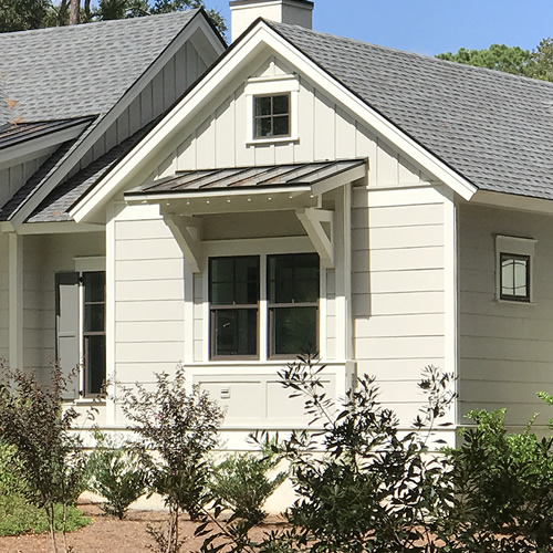 Farmhouse style metal roof over a window