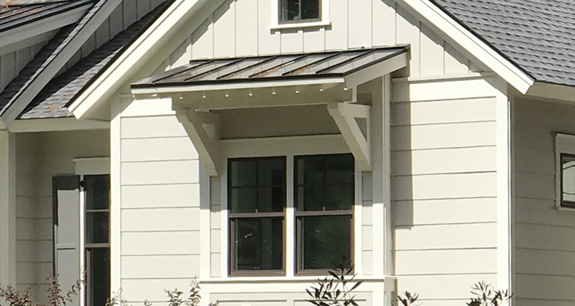 Shed Roof Over the Window on a Farmhouse Style House