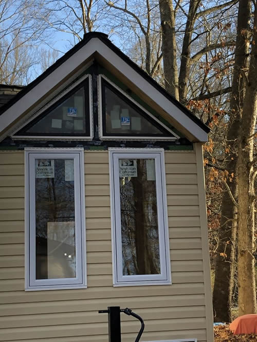 The front of the Tiny House Shell with windows, siding and shingles completed